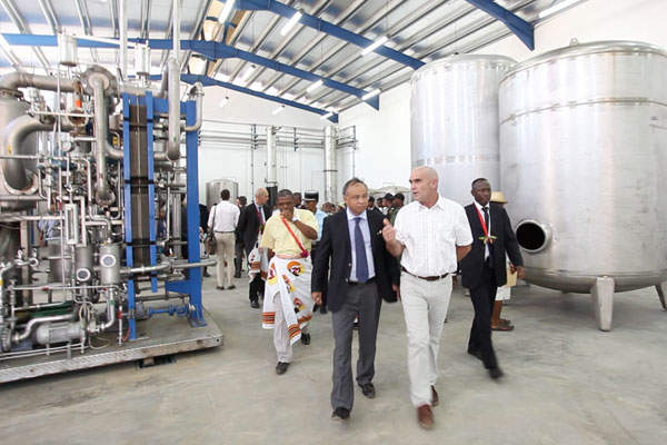 Officials visiting the new vanilla extraction facility in Benavony, Madagascar. Image courtesy of Symrise.