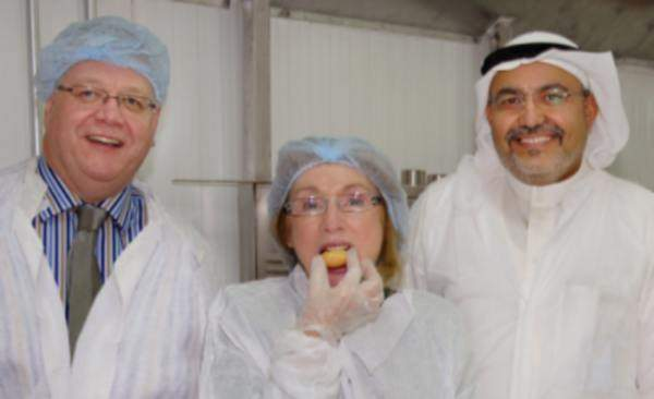 Ireland's Minister for Trade and Development Jan O'Sullivan, tasting a snack produced at Halwani Bros.' new industrial complex. Image courtesy of PM Group.