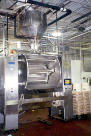 The dough is mixed in a Peerless mixer then pumped onto a conveyor that feeds the makeup line.