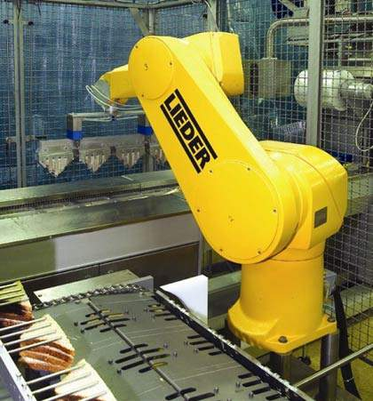 The company has invested heavily in new equipment at the majority of its plants; this robot arm aids in packing sandwiches for M&S (50 million per year).