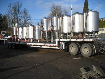 Brewery equipment being delivered from the Trask Brewing Company liquidation sale.