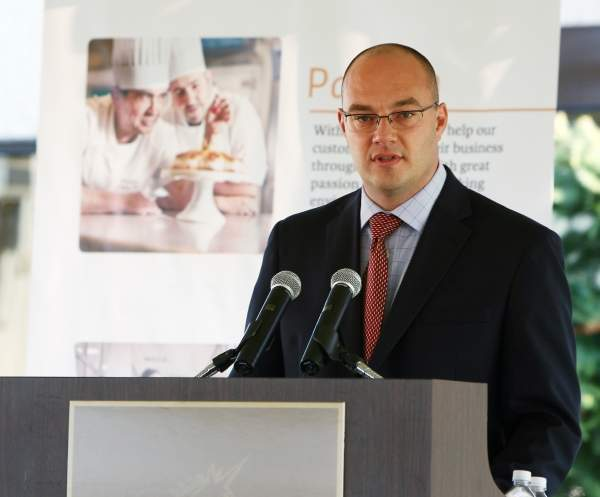 Matt Crumpton, Puratos' VP of Marketing, speaks at the groundbreaking ceremony of the Pennsauken plant expansion. Image courtesy of the State of New Jersey.
