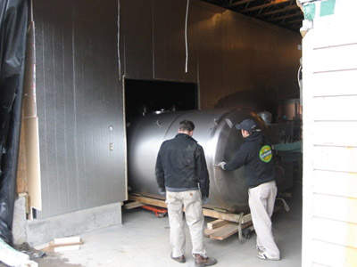 Serving tanks being installed into the refrigerated cooler at the Laurelwood brewery.