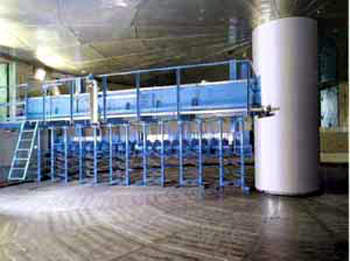 Circular stainless steel germination vessel.
