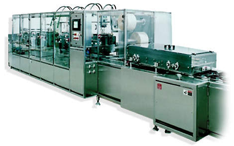 Piston filler used to dispense extremely precise fills into ready-meal packages.