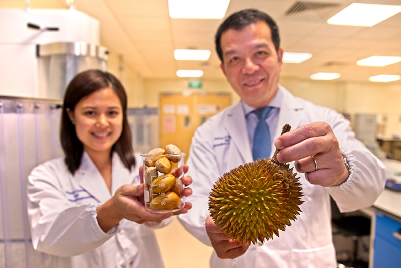 Scientists with Durian fruit