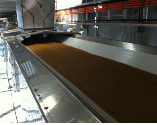 The conveyor is 1,000mm wide, composed of stainless steel and is conveying food grade malt at 180tph.