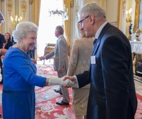 Queen Elizabeth II congratulates Ishida's Graham Clements