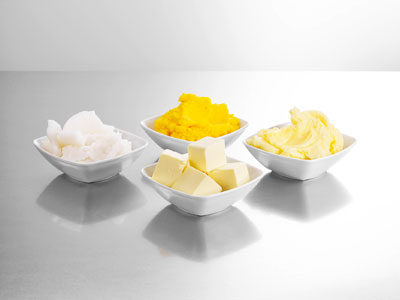 Four bowls with butter in, one cut into squares.